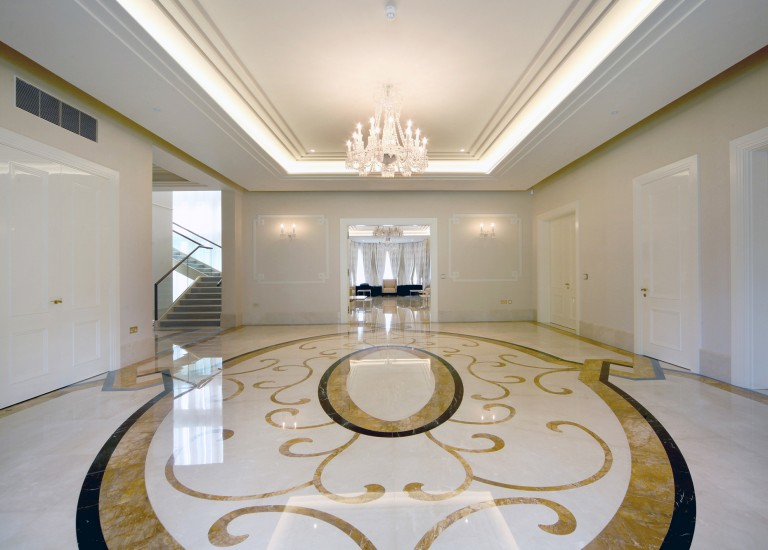 Hallway with Ornate Marble Flooring